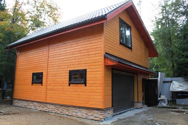 Современный гараж с мансардой